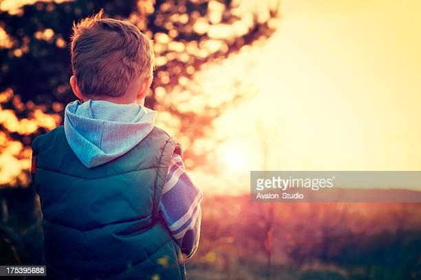 Child and sunset