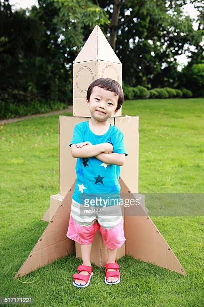 Child and Toy Space Rocket