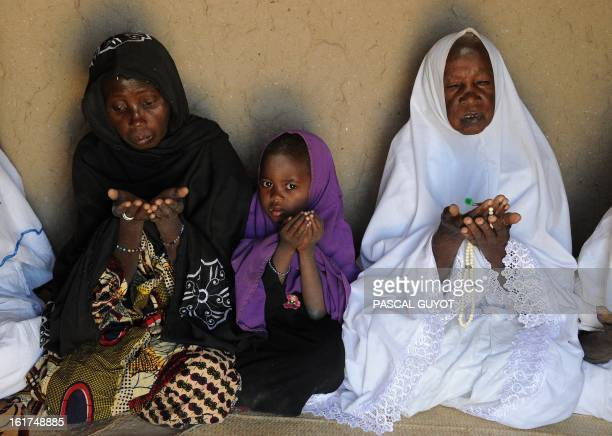 A child and two women pray on February 15 2013 in Gao northern Mali The European Union on Friday announced fresh aid worth 20 million euros to help...