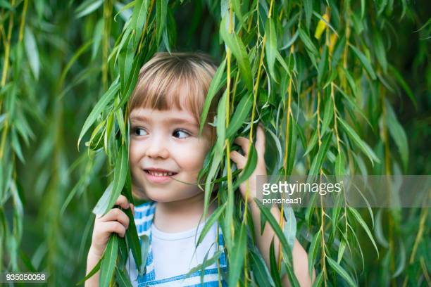 Child and weeping willow