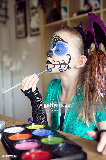 child applying halloween face paints - stage make up stock pictures, royalty-free photos & images