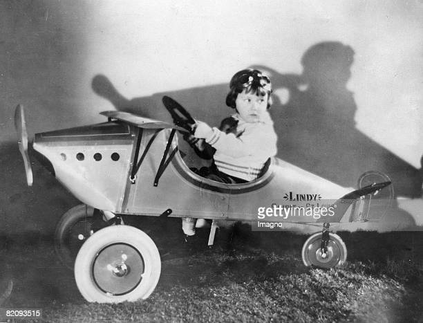 """Child as a pilot in a pedal car in form of Charles Lindberghs plane """"Spirit of St, Louis"""", America, Photograph, Around 1927 [Kind als Pilot in einem..."""