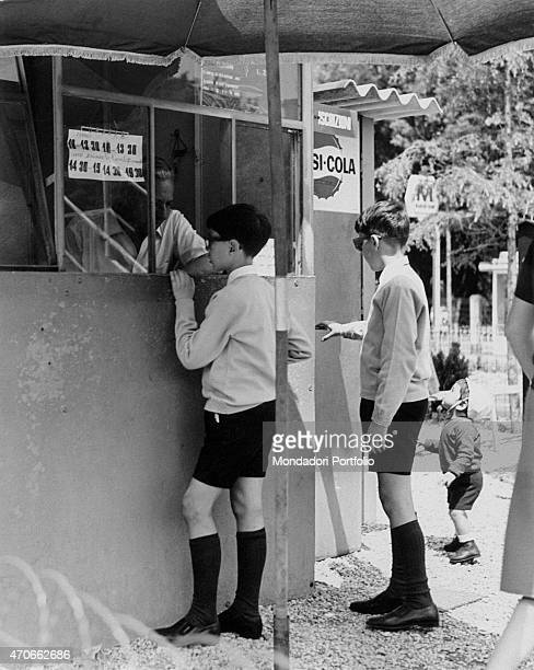 'A child asking for information at the ticket office of the Road Education Centre of the Eur district Rome 1966 '