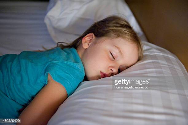 child asleep in bed