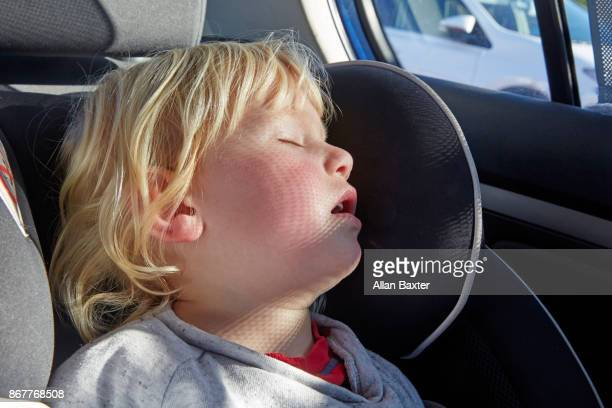 Child asleep in car seat in Hatchback car