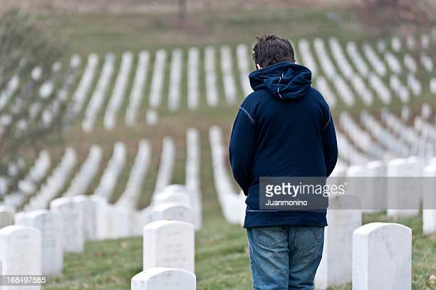 child at a cemetery - soldier praying stock photos and pictures