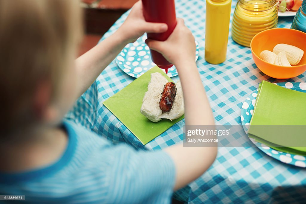 Child at a family barbecue : Stock Photo
