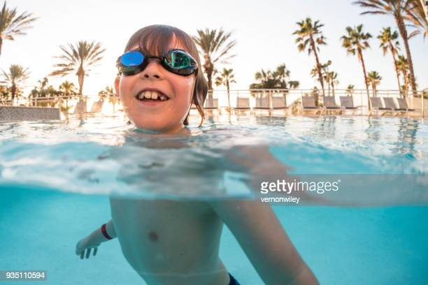 Child at a holiday resort pool