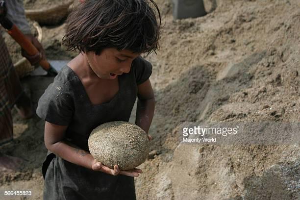 A child at a stone quarry on the bank of Dauki River Jaflong Sylhet Bangladesh January 19 2010