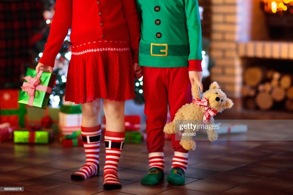 Child At Christmas Tree Kids At Fireplace On Xmas Stock Photo ...