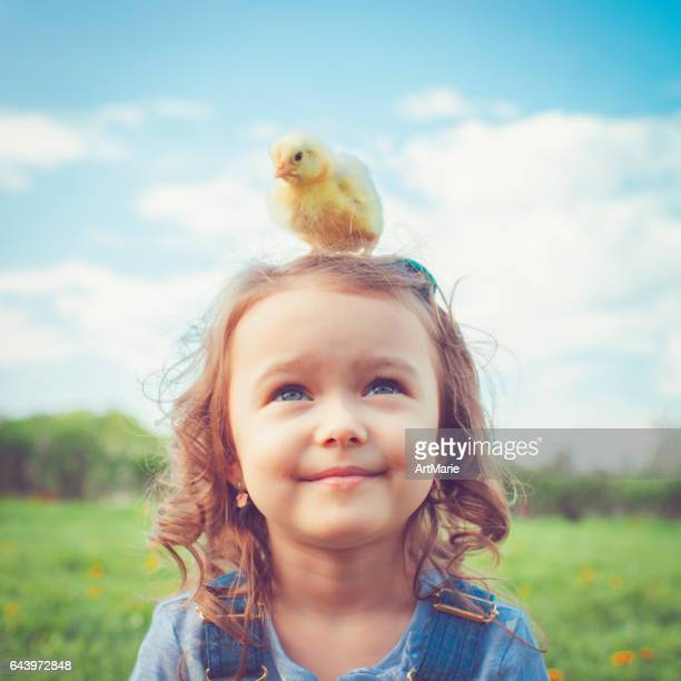 child at easter - bird stock photos and pictures