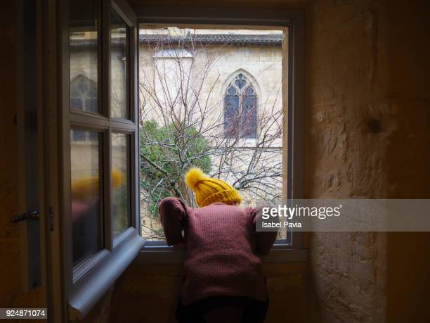 Child at home looking out of the window