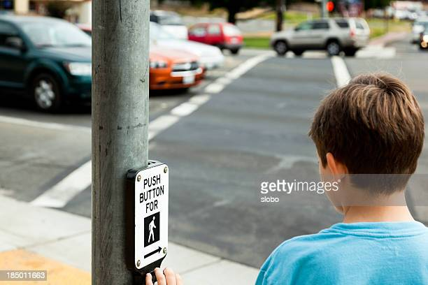 child at pedestrian crossing - pedestrian crossing stock photos and pictures