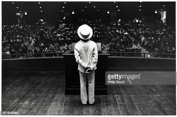 Child at Podium in Front of Crowd