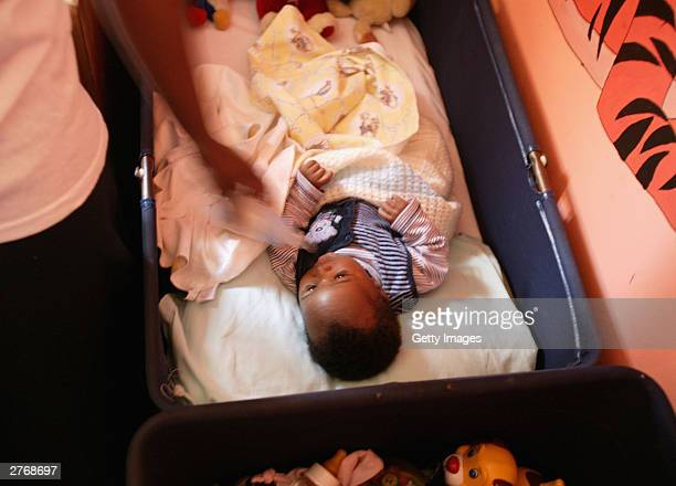 A child at the Baphumelele orphanage for children with AIDS whose parents have died of AIDS which was visited by singer Bono and singer Beyonce...
