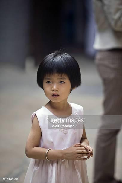 A child at the Thien Hau Pagoda Ho Chi Minh City Vietnam