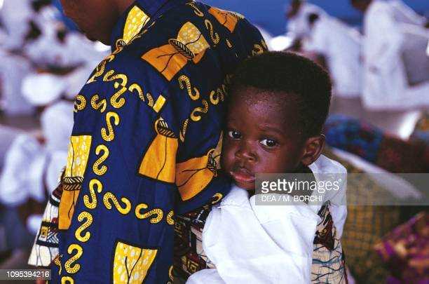 A child attending the celebration of Mass in the Temple of Celestial Christianity Lome Togo