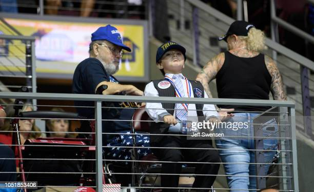 A child attends a rally hosted by US President Donald Trump at the Erie Insurance Arena on October 10 2018 in Erie Pennsylvania This was the second...