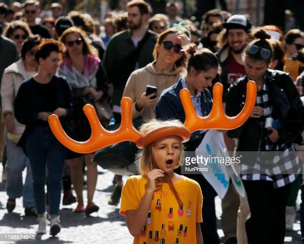 Child attends the 'All-Ukrainian march for animal rights' in center of Kiev, Ukraine, on 15 September 2019. Several thousands participants with their...