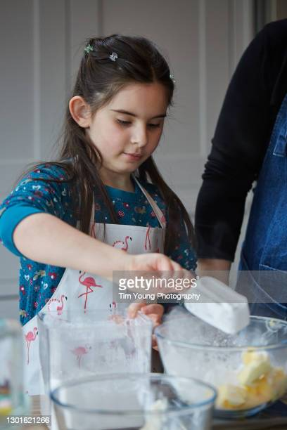 child baking with her mother - togetherness stock pictures, royalty-free photos & images