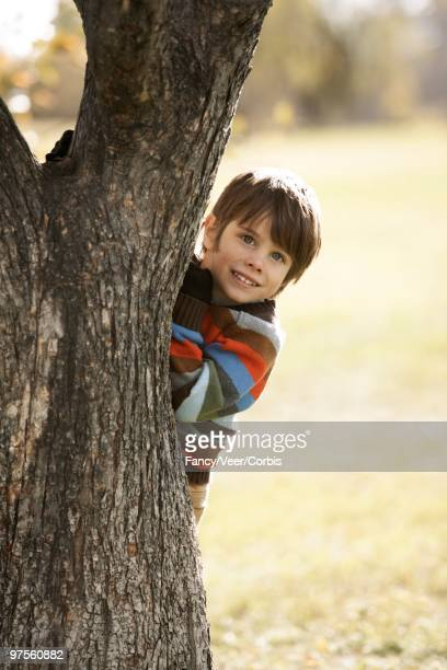 Child Behind a Tree