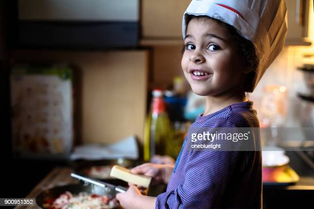 child being a chef - onebluelight stock pictures, royalty-free photos & images