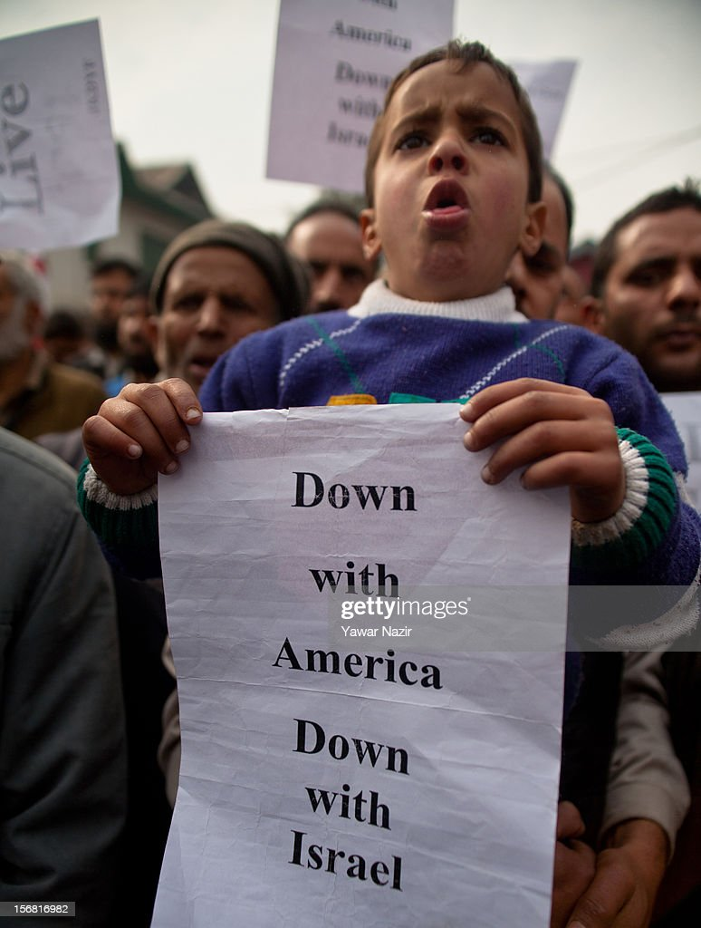 A child belonging to one of the Members of Jammu and Kashmir Democratic Youth Federation (JKDYF) an organisation which stands for communal harmony holds a placard during an anti Israeli protest and in solidarity with Gaza on November 22, 2012 in Srinagar, the summer capital of Indian administered Kashmir, India. Dozens of members of JKDYF were detained by Indian police when they were protesting against the recent Israeli strikes on Gaza