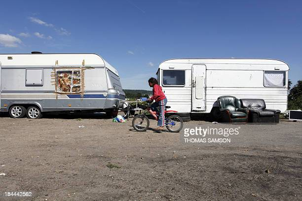 A child belonging to the Roma community rides a bicycle in a camp site on September 1st 2010 in TrielsurSeine Paris suburb France said on August 31...