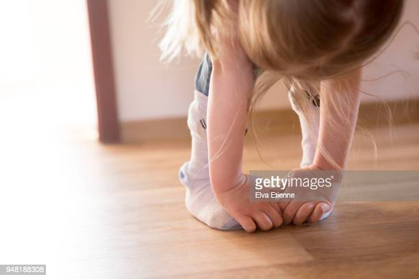 Child bending down and touching toes