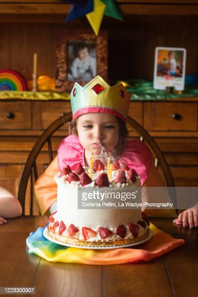 child blowing her birthday candles - happybirthdaycrown stock pictures, royalty-free photos & images