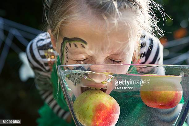 Child bobbing for apples
