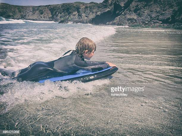 Child boogie boarding