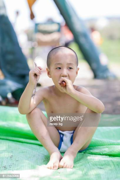 Child Boy Eating Sausage