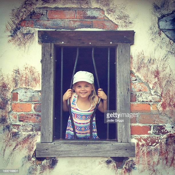 child breaking through prison bars - child behind bars stock pictures, royalty-free photos & images