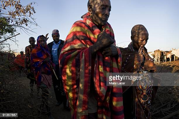 Child bride Seleyian Sekut and her uncle Oloitiring'ai Sekut are escorted away from their village by Narok district police officers after a raid on...