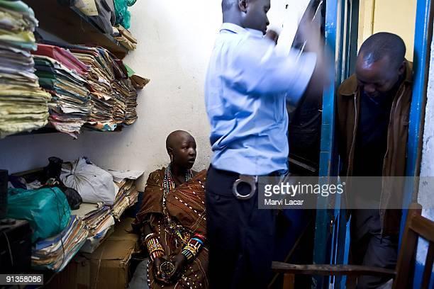 Child Bride Seleyian Sekut is comforted and questioned by Tasaru volunteer Chris Kamamia inside the police headquarters on December 5 2007 in Narok...