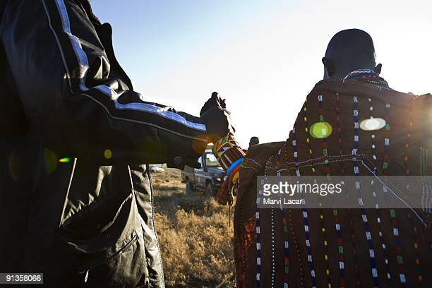 Child bride Seleyian Sekut is taken into protective custody by Narok district police officers after a raid on their village on December 5 2007 in...
