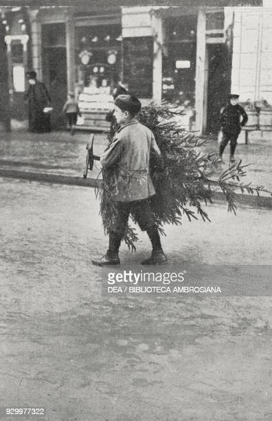 Child bringing home a Christmas tree, photograph by Adolfo Croce, from L'Illustrazione Italiana, Year XXXIII, No 51, December 23, 1906.