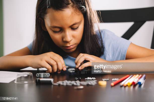 """child building a robot - """"marilyn nieves"""" stock pictures, royalty-free photos & images"""