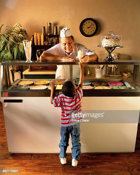 Child Buying Ice Cream at Ice Cream Parlor