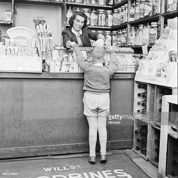 Child buying sweets at shop counter 9th April 1962