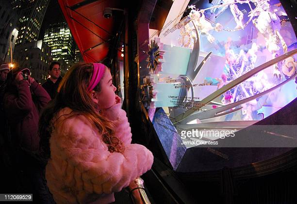Child bystander at the SAKS Fifth Ave window unveiling and snowflake lighting on November 20, 2006 in New York City