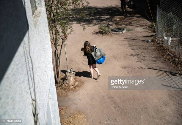 Child carries a pet from her apartment as her family was evicted for non-payment of rent on September 30, 2020 in Phoenix, Arizona. Thousands of...