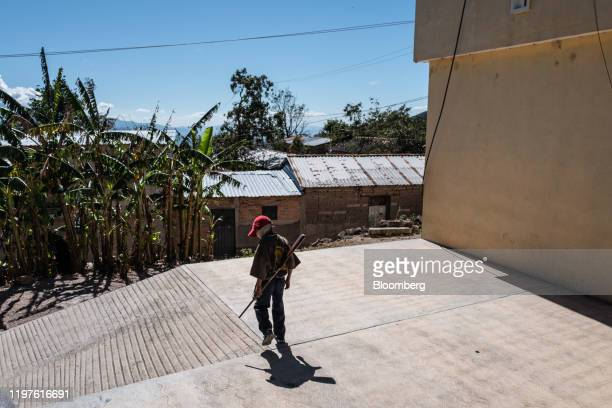Child carries a rifle during a Regional Coordinator of Community Authorities community police force gun training presentation held due to increased...
