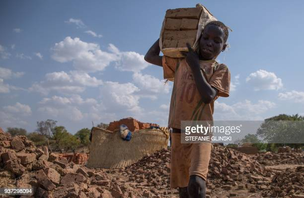 A child carries bricks to an oven near Nyamlel South Sudan on March 22 2018 Child labour has been on the rise in South Sudan a country where 60...