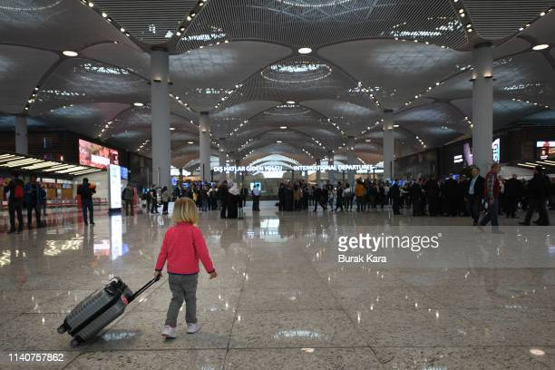 A child carries her luggage as she walks towards the departures terminal of the new Istanbul Airport on April 06 2019 in Istanbul Turkey Ataturk...