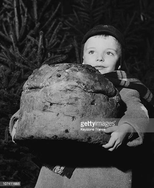 Child Carrying A Big Panettone In Milan On December 20Th 1958
