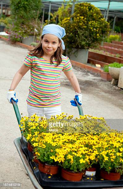 Child carrying flowers with a