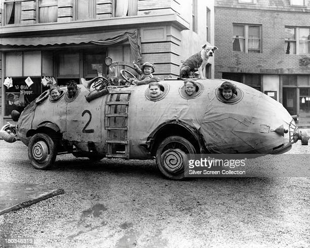 Child cast members riding in their unusual homemade car in a promotional still for 'Edison Marconi Co' a Hal Roach 'Our Gang' short silent film...