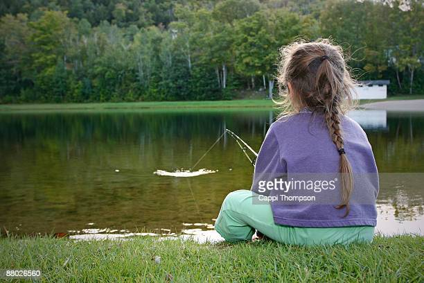 child catching fish - lake solitude (new hampshire) stock photos and pictures